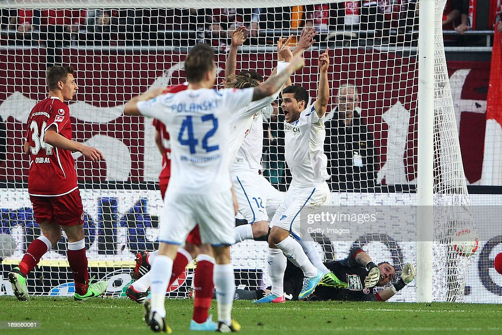 Kevin Volland of Hoffenheim celebrates after teammate David Abraham of Hoffenheim scored their team's first goal against goalkeeper Tobias Sippel of...