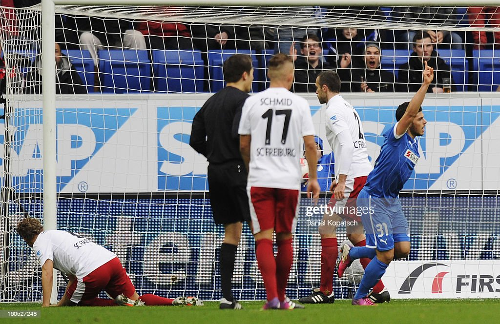 <a gi-track='captionPersonalityLinkClicked' href=/galleries/search?phrase=Kevin+Volland&family=editorial&specificpeople=6001755 ng-click='$event.stopPropagation()'>Kevin Volland</a> of Hoffenheim (R) celebrates his team's first goal during the Bundesliga match between TSG 1899 Hoffenheim and Sc Freiburg at Rhein-Neckar-Arena on February 2, 2013 in Sinsheim, Germany.