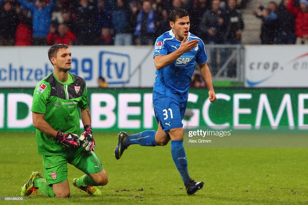 <a gi-track='captionPersonalityLinkClicked' href=/galleries/search?phrase=Kevin+Volland&family=editorial&specificpeople=6001755 ng-click='$event.stopPropagation()'>Kevin Volland</a> of Hoffenheim celebrates his team's second goal as goalkeeper <a gi-track='captionPersonalityLinkClicked' href=/galleries/search?phrase=Sven+Ulreich&family=editorial&specificpeople=4877030 ng-click='$event.stopPropagation()'>Sven Ulreich</a> of Stuttgart reacts during the Bundesliga match between 1899 Hoffenheim and VfB Stuttgart on February 15, 2014 in Sinsheim, Germany.