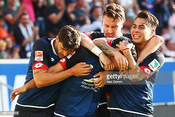 Kevin Volland of Hoffenheim celebrates his team's second goal with team mates Tobias Strobl Ermin Bicakcic and Eduardo Vargas during the Bundesliga...