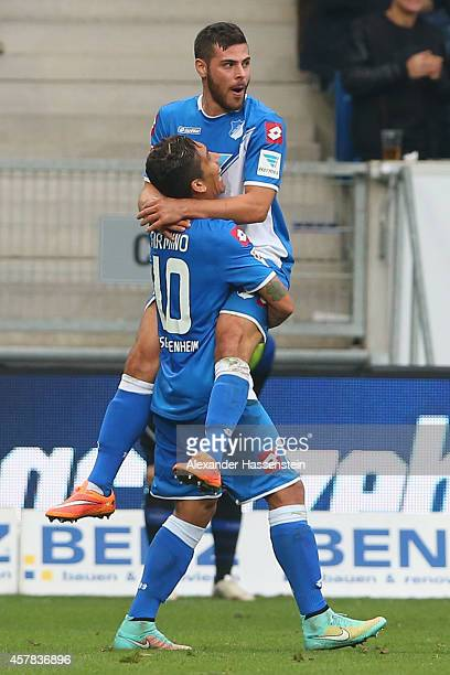 Kevin Volland of Hoffenheim celebrates scoring the opening goal with his team mate Roberto Firminio during the Bundesliga match between TSV 1899...