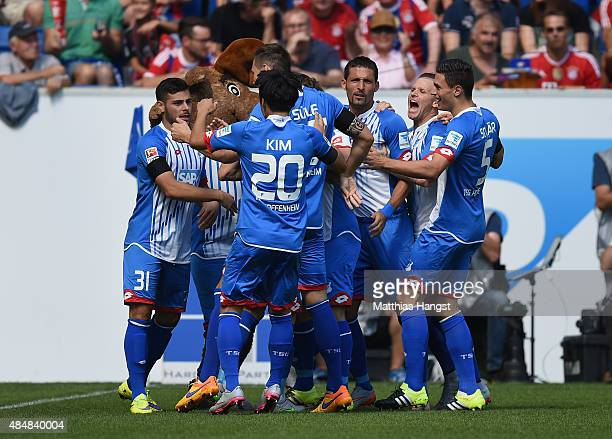 Kevin Volland of Hoffenheim celebrates with his teammates after scoring his team's first goal during the Bundesliga match between 1899 Hoffenheim and...