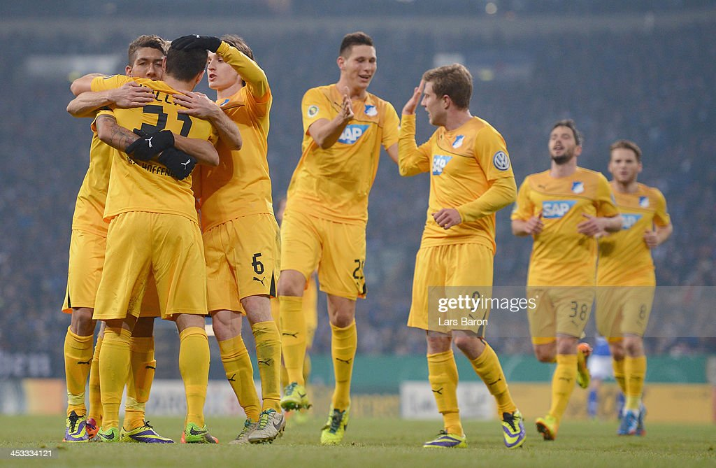 <a gi-track='captionPersonalityLinkClicked' href=/galleries/search?phrase=Kevin+Volland&family=editorial&specificpeople=6001755 ng-click='$event.stopPropagation()'>Kevin Volland</a> of Hoffenheim celebrates with team mate <a gi-track='captionPersonalityLinkClicked' href=/galleries/search?phrase=Roberto+Firmino+-+Soccer+Player&family=editorial&specificpeople=7522629 ng-click='$event.stopPropagation()'>Roberto Firmino</a> and other team mates after scoring his teams second goal during the DFB Cup round of 16 match between FC Schalke 04 and 1899 Hoffenheim at Veltins-Arena on December 3, 2013 in Gelsenkirchen, Germany.