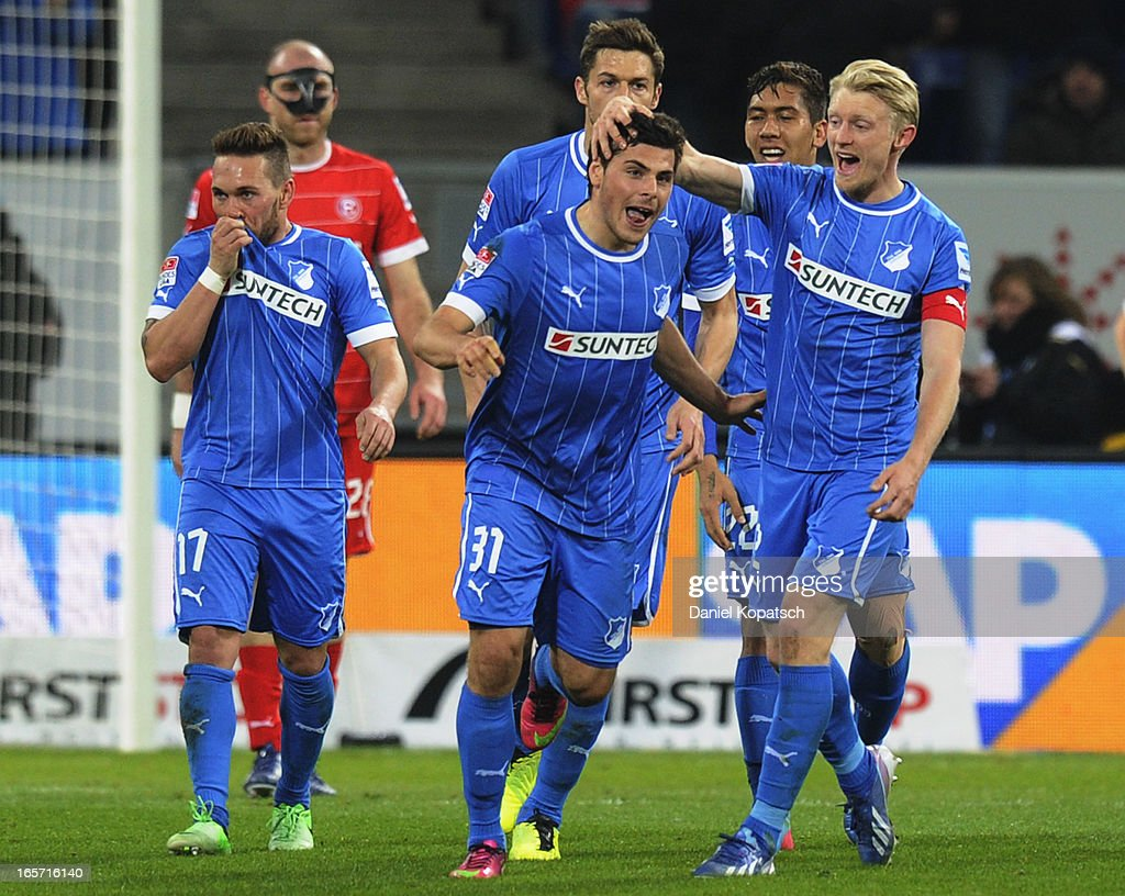 <a gi-track='captionPersonalityLinkClicked' href=/galleries/search?phrase=Kevin+Volland&family=editorial&specificpeople=6001755 ng-click='$event.stopPropagation()'>Kevin Volland</a> (C) of Hoffenheim celebrates with team-mates after scoring their team's third goal during the Bundesliga match between TSG 1899 Hoffenheim and Fortuna Duesseldorf 1895 at Rhein-Neckar-Arena on April 5, 2013 in Sinsheim, Germany.