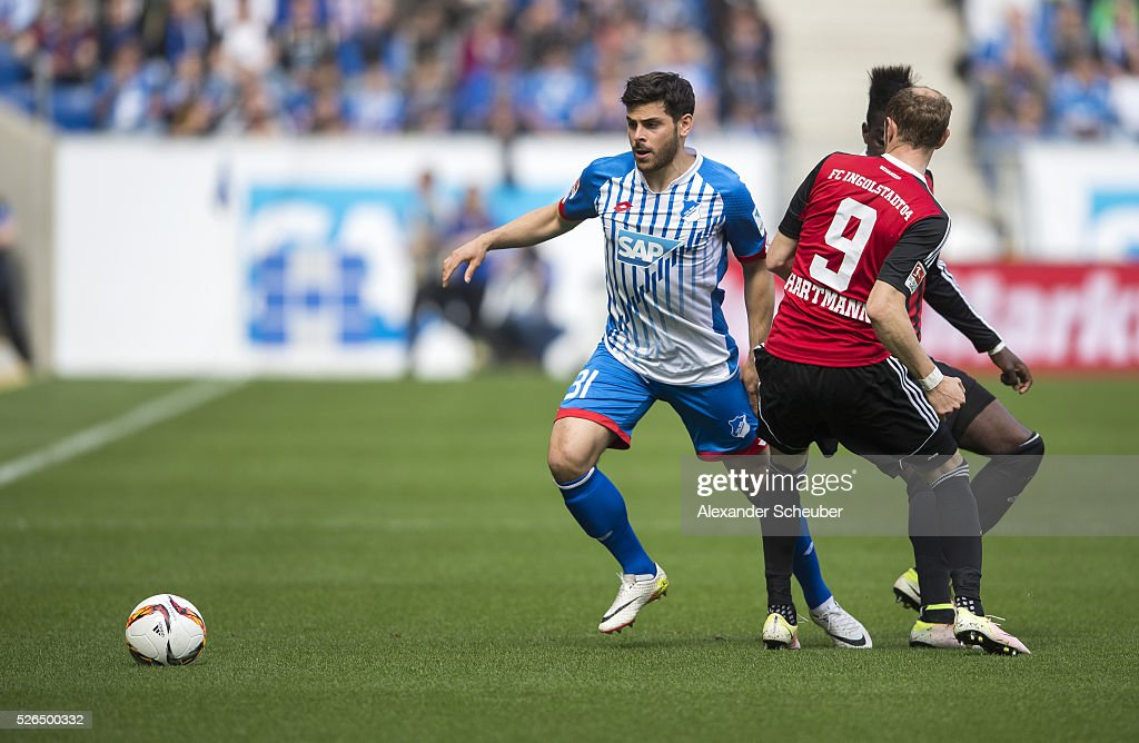 Kevin Volland of Hoffenheim challenges Moritz Hartmann of FC Ingolstadt during the first bundesliga match between 1899 Hoffenheim and FC Ingolstadt at Wirsol Rhein-Neckar-Arena on April 30, 2016 in Sinsheim, Germany.