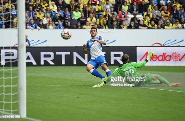 Kevin Volland of Hoffenheim scores his team's first goal past goalkeeper Mitchell Langerak of Dortmund during the Bundesliga match between 1899...