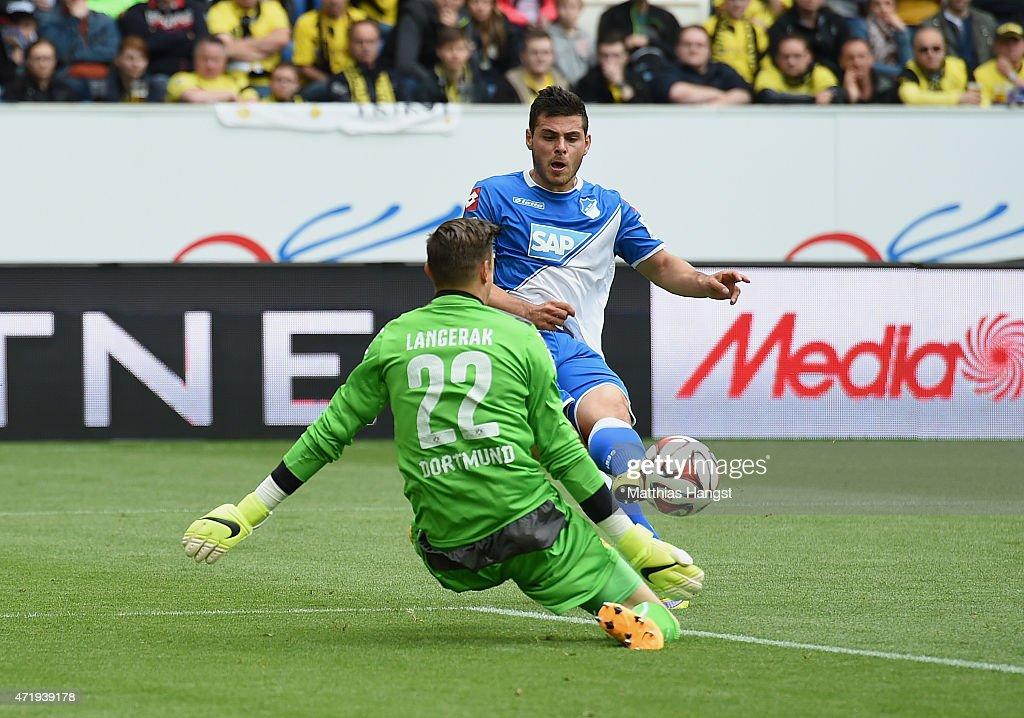 Kevin Volland of Hoffenheim scores his team's first goal past goalkeeper Mitchell Langerak of Dortmund during the Bundesliga match between 1899 Hoffenheim and Borussia Dortmund at Wirsol Rhein-Neckar-Arena on May 2, 2015 in Sinsheim, Germany.