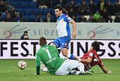 Kevin Volland of Hoffenheim scores his team's second goal past goalkeeper RonRobert Zieler of Hannover and Miiko Albornoz of Hannover during the...