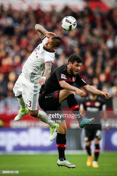 Kevin Volland of Leverkusen and Arturo Vidal of Bayern battle for the ball during the Bundesliga match between Bayer 04 Leverkusen and Bayern...
