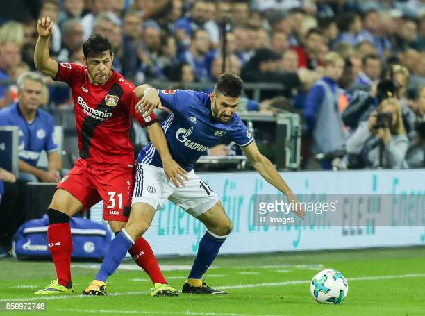 Kevin Volland of Leverkusen and Daniel Caligiuri of Schalke battle for the ball during the Bundesliga match between FC Schalke 04 and Bayer 04...