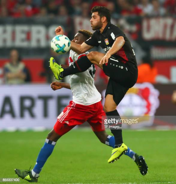 Kevin Volland of Leverkusen and Gideon Jung of Hamburg battle for the ball during the Bundesliga match between Bayer 04 Leverkusen and Hamburger SV...