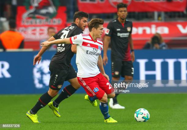 Kevin Volland of Leverkusen and Gotoku Sakai of Hamburg battle for the ball during the Bundesliga match between Bayer 04 Leverkusen and Hamburger SV...