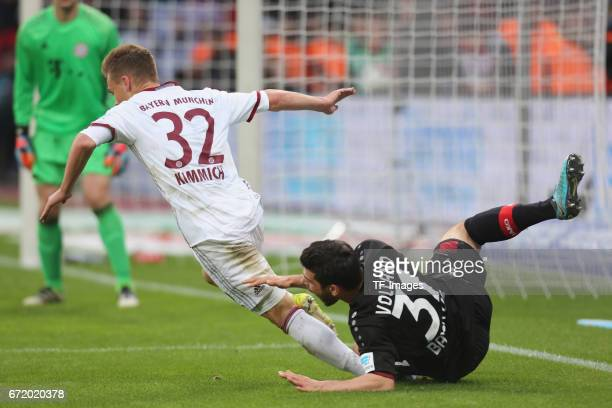 Kevin Volland of Leverkusen and Joshua Kimmich of Munich battle for the ball during the Bundesliga match between Bayer 04 Leverkusen and Bayern...