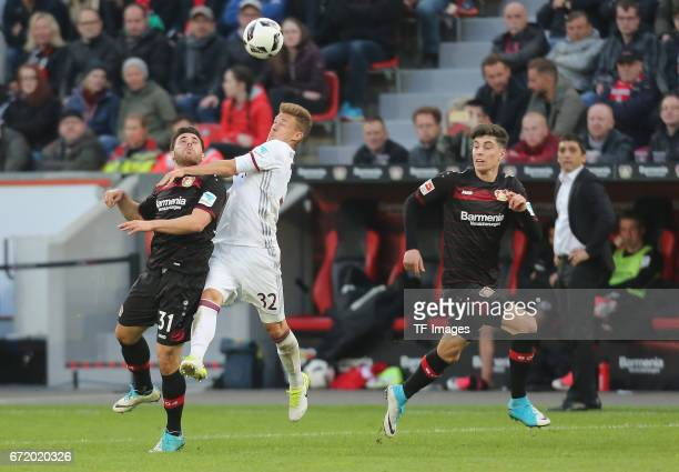 Kevin Volland of Leverkusen and Joshua Kimmich of Munich looks on during the Bundesliga match between Bayer 04 Leverkusen and Bayern Muenchen at...