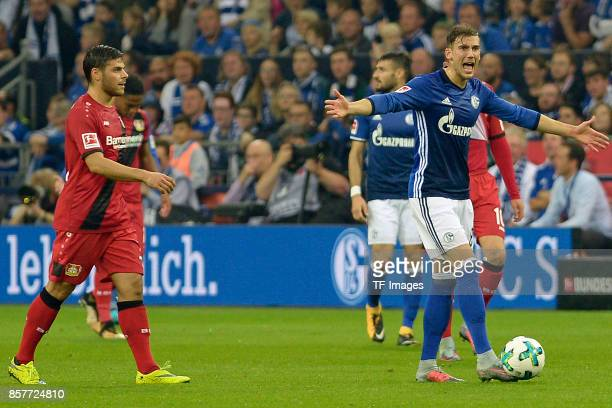 Kevin Volland of Leverkusen and Leon Goretzka of Schalke looks on during the Bundesliga match between FC Schalke 04 and Bayer 04 Leverkusen at...