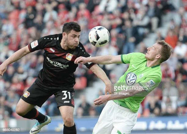 Kevin Volland of Leverkusen and Maximilian Arnold of Wolfsburg battle for the ball during the Bundesliga match between Bayer 04 Leverkusen and VfL...