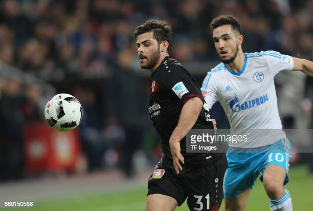 Kevin Volland of Leverkusen and Nabil Bentaleb of Schalke battle for the ball during to the Bundesliga match between Bayer 04 Leverkusen and FC...