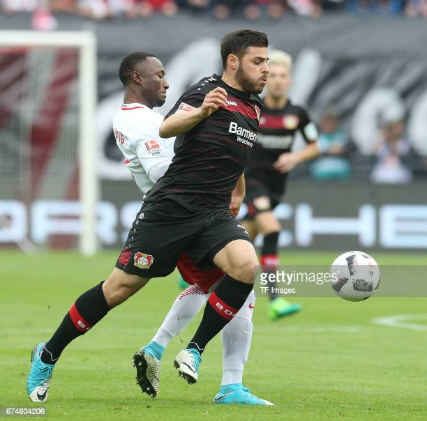 Kevin Volland of Leverkusen and Naby Keita of Leipzig battle for the ball during the Bundesliga match between RB Leipzig and Bayer 04 Leverkusen at...