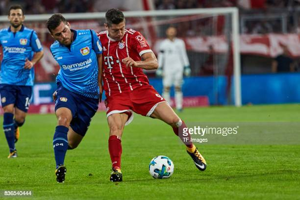 Kevin Volland of Leverkusen and Robert Lewandowski of Muenchen battle for the ball during the Bundesliga match between FC Bayern Muenchen and Bayer...