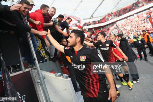 Kevin Volland of Leverkusen and team mates celebrate with the fans after the Bundesliga match between Bayer 04 Leverkusen and SC Freiburg at BayArena...