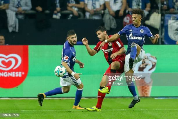 Kevin Volland of Leverkusen and Thilo Kehrer of Schalke battle for the ball during the Bundesliga match between FC Schalke 04 and Bayer 04 Leverkusen...