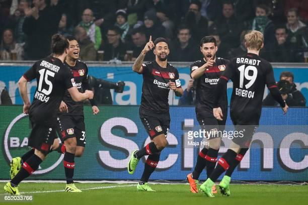 Kevin Volland of Leverkusen celebrates his team's first goal with team mates Julian Baumgartlinger Benjamin Henrichs and Julian Brandt during the...