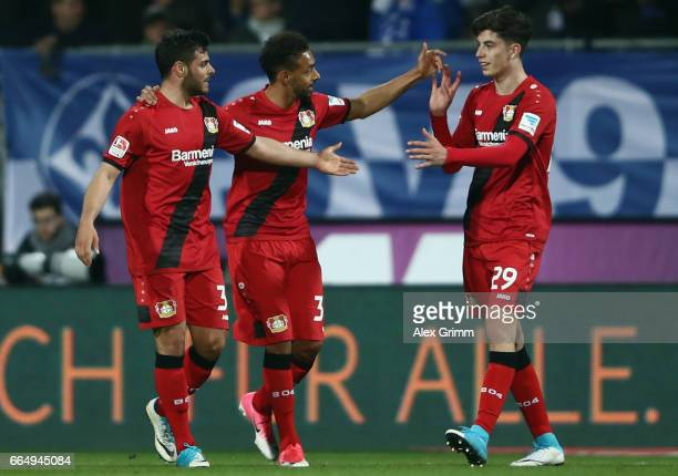 Kevin Volland of Leverkusen celebrates his team's second goal with team mates Karim Bellarabi and Kai Havertz during the Bundesliga match between SV...