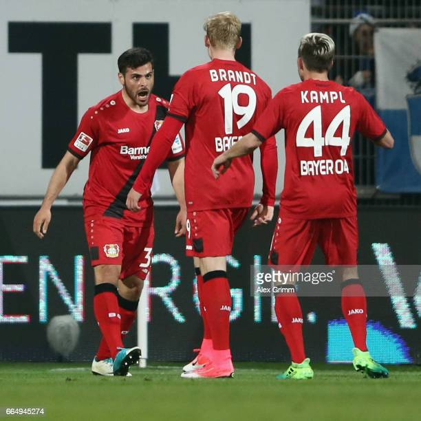 Kevin Volland of Leverkusen celebrates his team's second goal with team mates Julian Brandt and Kevin Kampl during the Bundesliga match between SV...