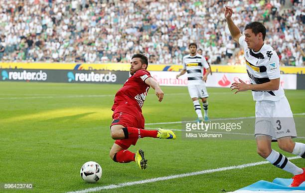 Kevin Volland of Leverkusen fights for the ball against Andreas Christensen of Moenchengladbach during the Bundesliga match between Borussia...