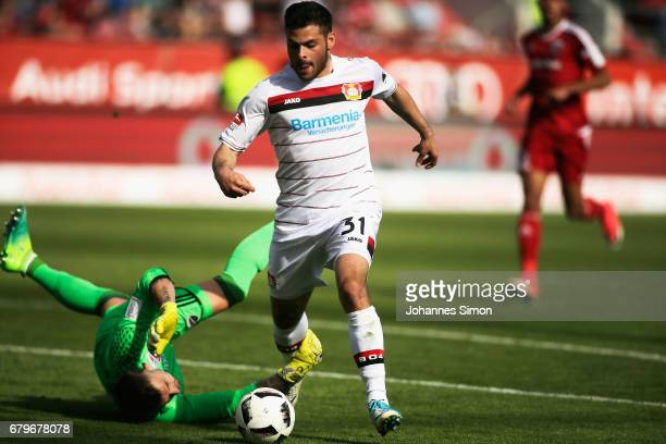 Kevin Volland of Leverkusen tries to score against Martin Hansen goalkeeper of Ingolstadt during the Bundesliga match between FC Ingolstadt 04 and...