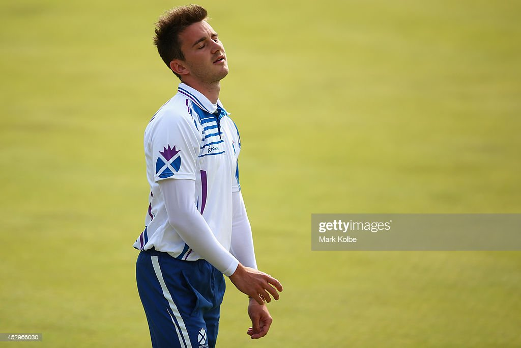 Kevin Wallace of Scotland looks dejected in the bronze medal Para-Sport Open Triples B6/B7/B8 lawn bowls match between England and Scotland at Kelvingrove Lawn Bowls Centre during day eight of the Glasgow 2014 Commonwealth Games on July 31, 2014 in Glasgow, United Kingdom.