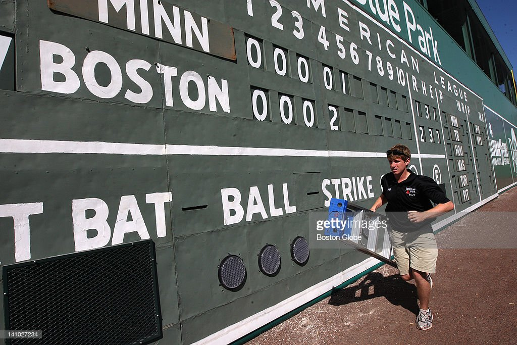 Kevin Walsh the Red Sox manual scoreboard operator changes the score with his six foot ladder during a spring training game against Minnesota at...