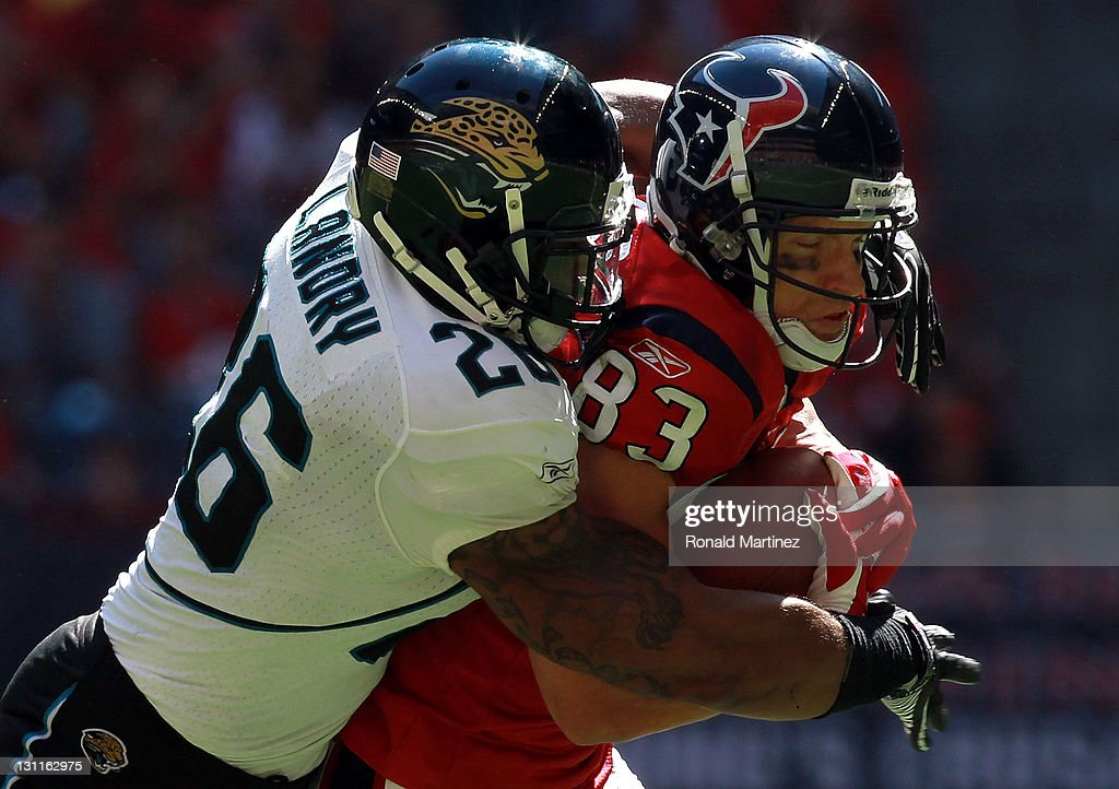 Kevin Walter #83 of the Houston Texans runs against <a gi-track='captionPersonalityLinkClicked' href=/galleries/search?phrase=Dawan+Landry&family=editorial&specificpeople=575013 ng-click='$event.stopPropagation()'>Dawan Landry</a> #26 of the Jacksonville Jaguars at Reliant Stadium on October 30, 2011 in Houston, Texas.