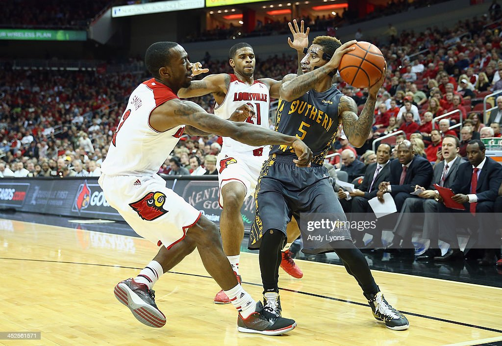 Kevin Ware #2 and Chane Behanan #21 of the Louisville Cardinals defend Nell Watson #5 of the Southern Mississippi Golden Eagles at KFC YUM! Center on November 29, 2013 in Louisville, Kentucky.