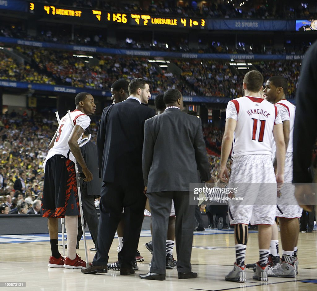 Kevin Ware (5) of Louisville goes out on the floor during a timeout in the second half of a semi-final matchup against Wichita State in the NCAA Men's Basketball Championship at the Georgia Dome in Atlanta, Georgia, Saturday, April 6, 2013.