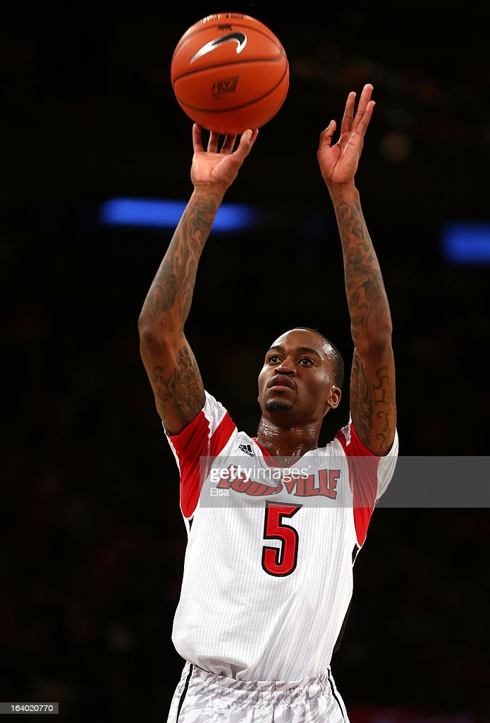 Kevin Ware #5 of the Louisville Cardinals attempts a free throw against the Syracuse Orange during the final of the Big East Men's Basketball Tournament at Madison Square Garden on March 16, 2013 in New York City.