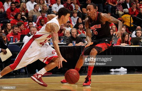 Kevin Ware of the Louisville Cardinals defends Brandon Harris of the Western Kentucky Hilltoppers at Bridgestone Arena on December 22 2012 in...