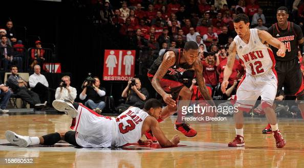Kevin Ware of the Louisville Cardinals dribbles the ball between Teeng Akol and Percy Blade of the Western Kentucky Hilltoppers at Bridgestone Arena...