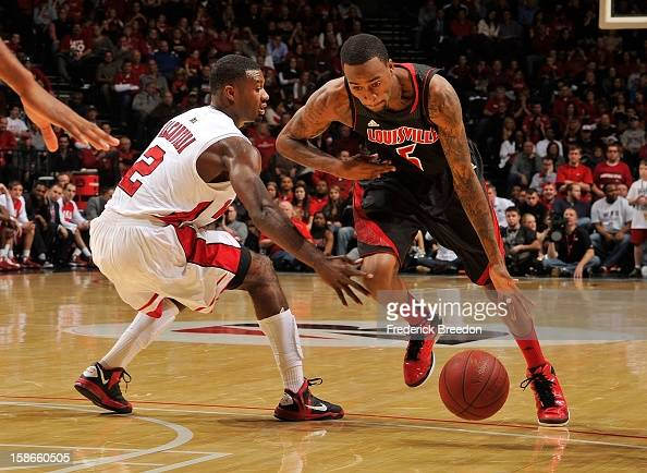 Kevin Ware of the Louisville Cardinals drives toward Eddie Alcantara of the Western Kentucky Hilltoppers at Bridgestone Arena on December 22 2012 in...
