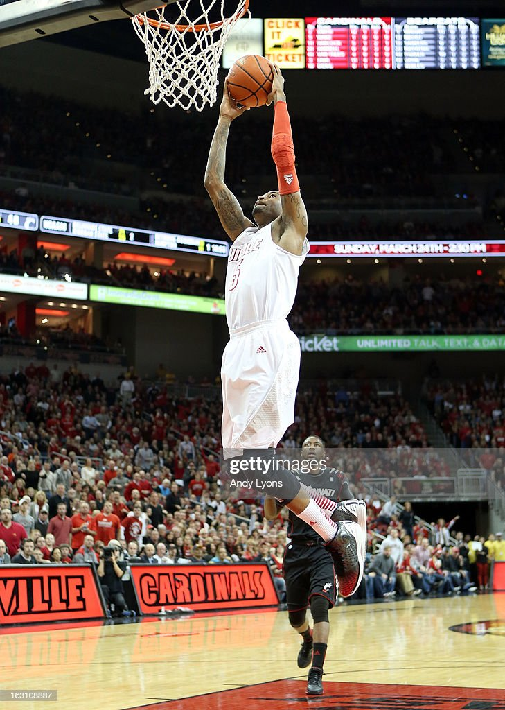 Kevin Ware #5 of the Louisville Cardinals dunks the ball during the game against the Cincinnati Bearcats at KFC YUM! Center on March 4, 2013 in Louisville, Kentucky.