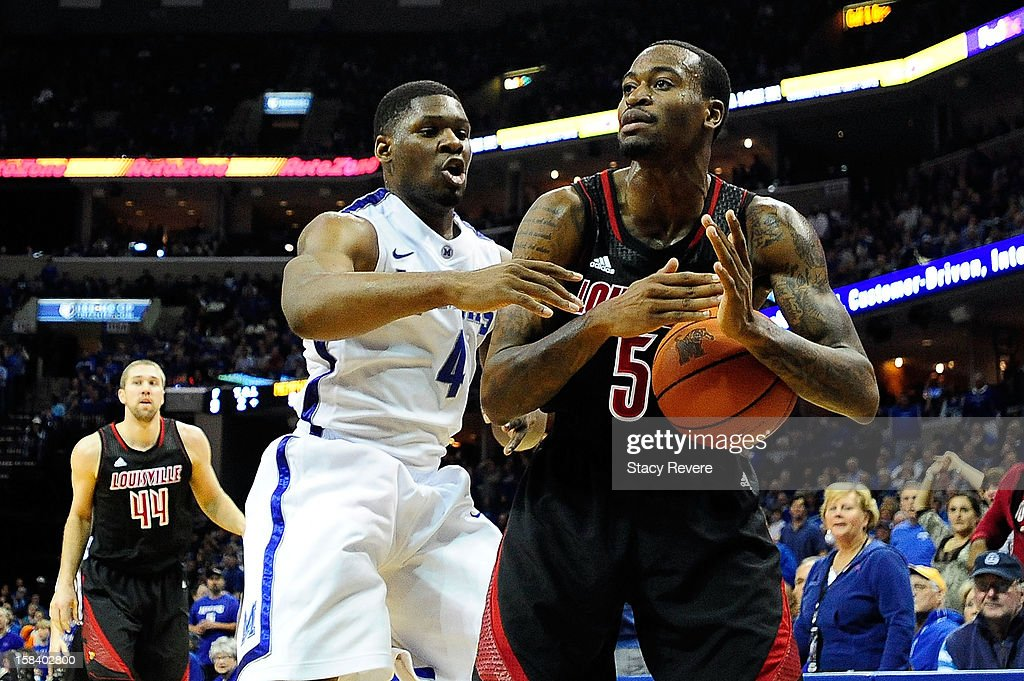 Kevin Ware #5 of the Louisville Cardinals is defended by Adonis Thomas #4 of the Memphis Tigers during a game at FedExForum on December 15, 2012 in Memphis, Tennessee.