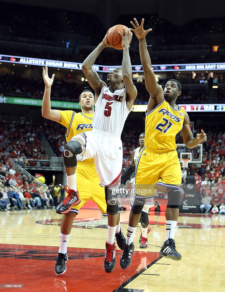 Kevin Ware #5 of the Louisville Cardinals shoots the ball during the game against the Missouri-Kansas City Kangaroos at KFC YUM! Center on December 8, 2012 in Louisville, Kentucky.