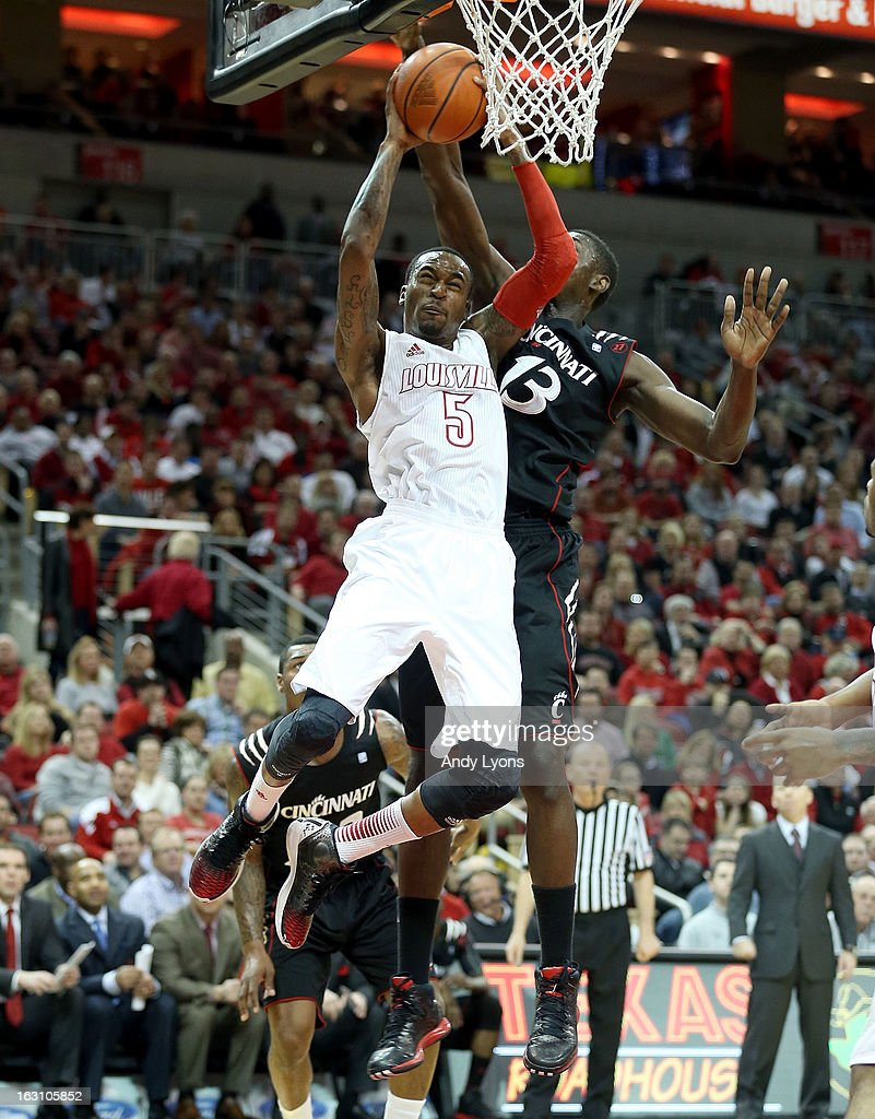 Kevin Ware #5 of the Louisville Cardinals shoots the ball during the game against the Cincinnati Bearcats at KFC YUM! Center on March 4, 2013 in Louisville, Kentucky.