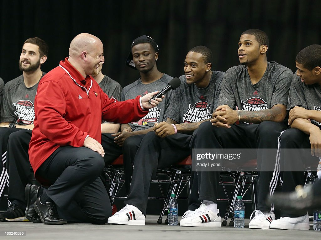 <a gi-track='captionPersonalityLinkClicked' href=/galleries/search?phrase=Kevin+Ware+-+Basketballer&family=editorial&specificpeople=8772504 ng-click='$event.stopPropagation()'>Kevin Ware</a> (third from right) of the Louisville Cardinals talks during the Louisville Cardinals NCAA Basketball Celebration to mark the NCAA championship by the Mens team and the runner-up finish by the womens team at KFC YUM! Center on April 10, 2013 in Louisville, Kentucky.
