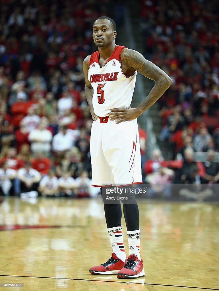 Kevin Ware #5 of the Louisville Cardinals watches the action during the game against the Southern Mississippi Golden Eagles at KFC YUM! Center on November 29, 2013 in Louisville, Kentucky.