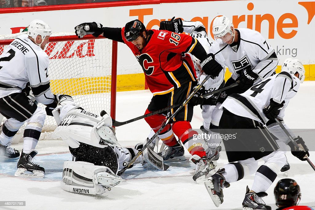 <a gi-track='captionPersonalityLinkClicked' href=/galleries/search?phrase=Kevin+Westgarth&family=editorial&specificpeople=4537296 ng-click='$event.stopPropagation()'>Kevin Westgarth</a> #15 of the Calgary Flames looks for a rebound against a sprawling <a gi-track='captionPersonalityLinkClicked' href=/galleries/search?phrase=Jonathan+Quick&family=editorial&specificpeople=2271852 ng-click='$event.stopPropagation()'>Jonathan Quick</a> #32 of the Los Angeles Kings at Scotiabank Saddledome on April 9, 2014 in Calgary, Alberta, Canada.