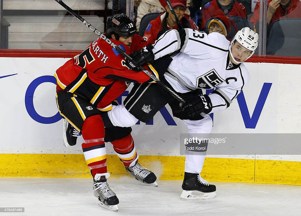 <a gi-track='captionPersonalityLinkClicked' href=/galleries/search?phrase=Kevin+Westgarth&family=editorial&specificpeople=4537296 ng-click='$event.stopPropagation()'>Kevin Westgarth</a> (L) of the Calgary Flames pushes Dustin Brown of the Los Angeles Kings away from the puck during the first period of their NHL hockey game at the Scotiabank Saddledome February 27, 2014 in Calgary, Alberta, Canada.