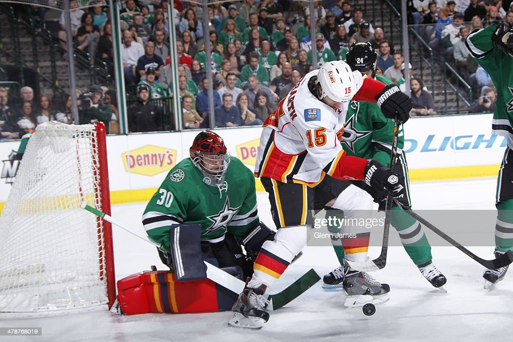 <a gi-track='captionPersonalityLinkClicked' href=/galleries/search?phrase=Kevin+Westgarth&family=editorial&specificpeople=4537296 ng-click='$event.stopPropagation()'>Kevin Westgarth</a> #15 of the Calgary Flames tries to redirect a puck against Tim Thomas #30 of the Dallas Stars at the American Airlines Center on March 14, 2014 in Dallas, Texas.