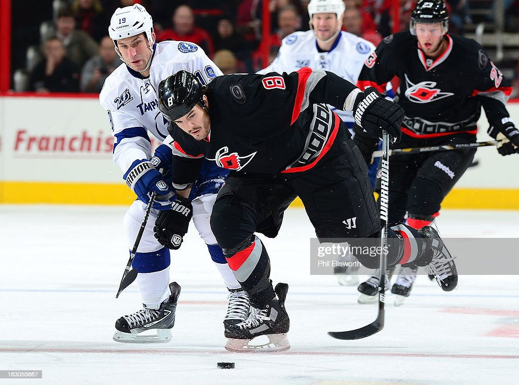 Kevin Westgarth #8 of the Carolina Hurricanes battles the defense of <a gi-track='captionPersonalityLinkClicked' href=/galleries/search?phrase=B.J.+Crombeen&family=editorial&specificpeople=4505846 ng-click='$event.stopPropagation()'>B.J. Crombeen</a> #19 of the Tampa Bay Lightning during an NHL game on February 23, 2013 at PNC Arena in Raleigh, North Carolina.
