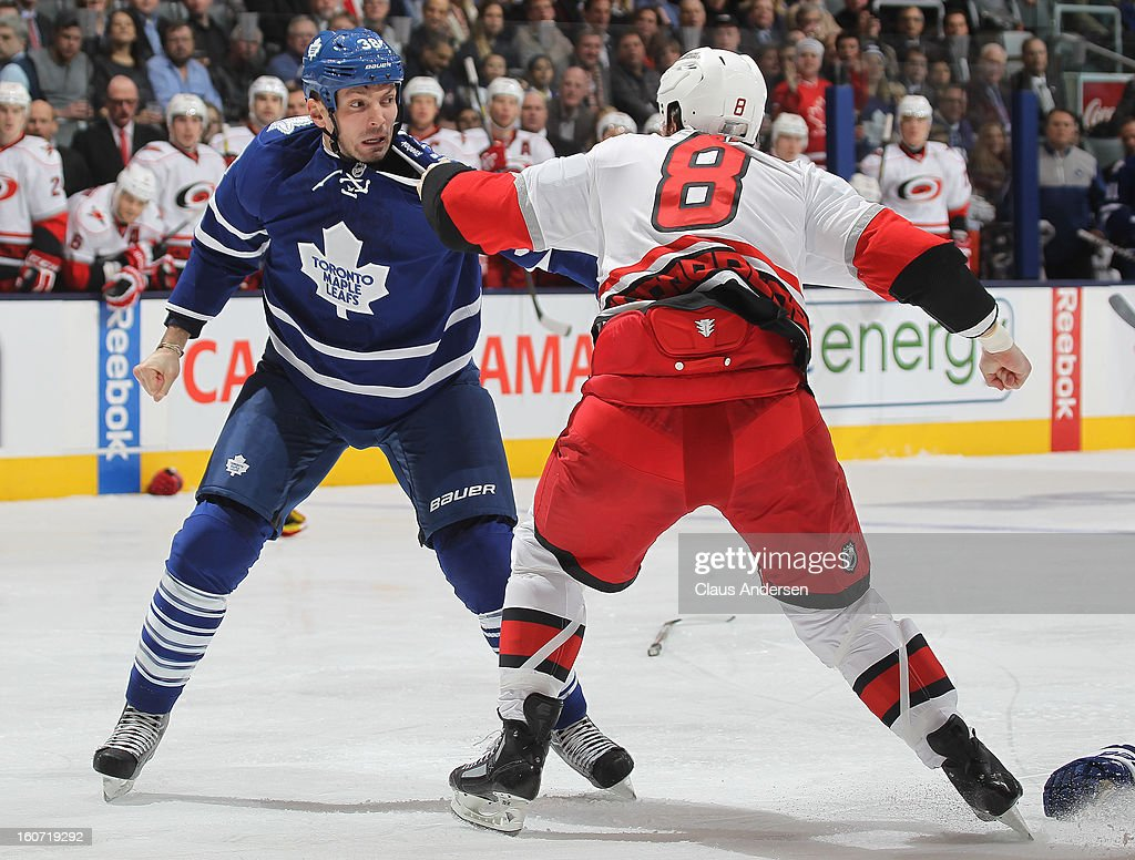 Kevin Westgarth #8 of the Carolina Hurricanes dukes it out with Frazer McLaren #38 of the Toronto Maple Leafs in a game on February 4, 2013 at the Air Canada Centre in Toronto, Canada.